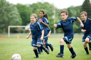 boys and girls playing soccer in blue jerseys